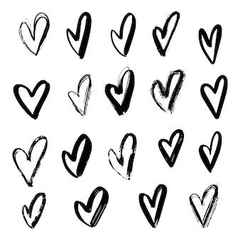 Zestaw ręcznie rysowane serca. elementy projektu na walentynki, kartkę z życzeniami, baner sprzedaży. element miłości