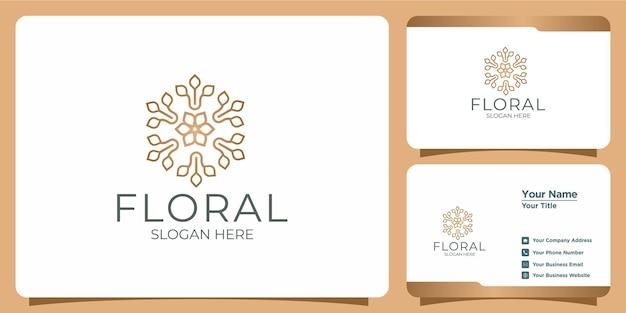 Zestaw ręcznie rysowanych kobiecych i nowoczesnych logo szablonów kwiatowych i wizytówek