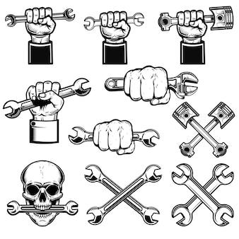 Zestaw ręki z narzędziami roboczymi, kluczami. dyżurny mechanik. element projektu logo, etykiety, godła, znaku, plakatu.