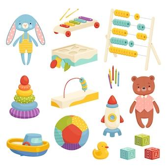 Zestaw różnych jasnych zabawek dla dzieci. wyposażenie do gier i rozrywki dla dzieci. zabawki sportowe, pluszowe, muzyczne i logiczne. na białym tle.