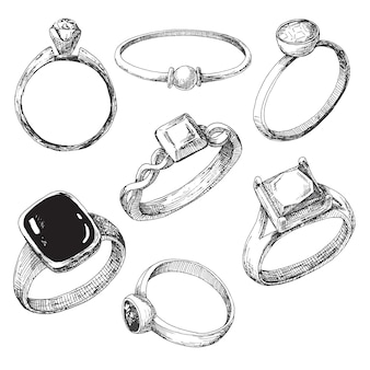 Zestaw różnych pierścieni biżuterii na białym tle