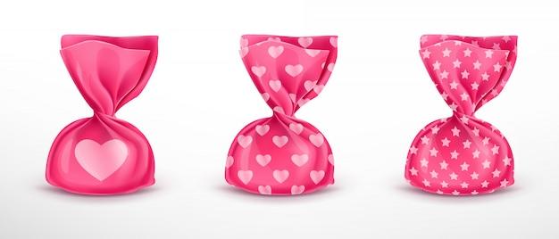 Zestaw różowych opakowań cukierków z wzorami