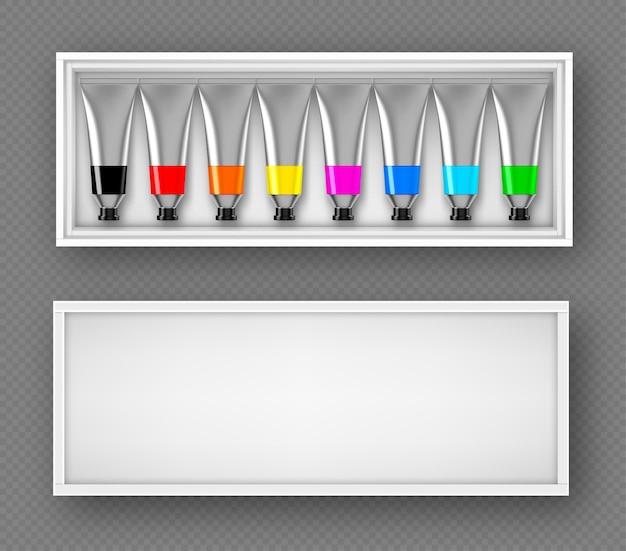 Zestaw rurek z farbami w pudełku z widokiem z góry kolorowa paleta z barwnikiem olejowym lub akrylowym w metalowych aluminiowych butelkach na białym tle