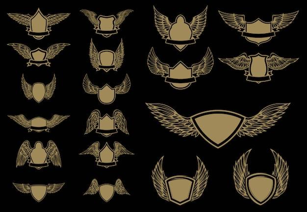 Zestaw skrzydlatych emblematów w złotym stylu. element, etykieta, godło, znak. ilustracja.