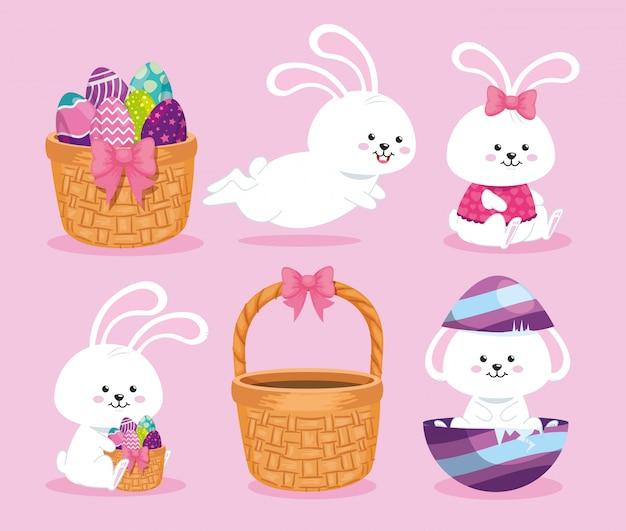 Zestaw ślicznych królików i koszy wiklinowych z jajami wielkanocnymi