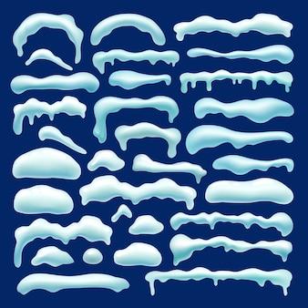 Zestaw śnieżki, czapy śnieżne, sople, zaspa śnieżna.