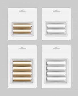 Zestaw srebrnych złotych baterii w blistrze na białym tle