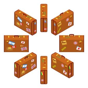 Zestaw stojących brązowych walizek podróżnych