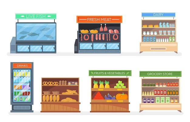 Zestaw stojaków i lodówek z jedzeniem