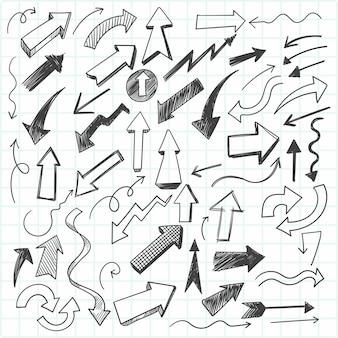 Zestaw strzałek ręcznie rysowane gryzmoły, styl szkicu