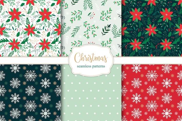 Zestaw świątecznych bez szwu wzorów z gałęzi, liści i jagód poinsettia oraz płatki śniegu.
