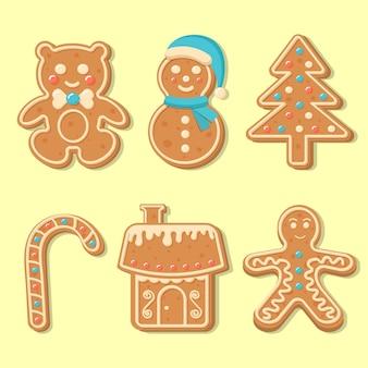 Zestaw świątecznych pierników. cukierki świąteczne, niedźwiedź, bałwan, piernik, drzewo sylwestrowe, dom. figurki wesołych świąt i szczęśliwego nowego roku pokryte cukrem pudrem.