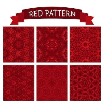 Zestaw świątecznych wzorów haftów w kolorze czerwonym. idealny do tapet, wypełnień deseniem, teł internetowych, tekstur powierzchni, kart, opakowań na prezent
