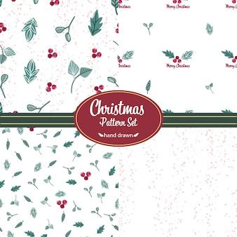 Zestaw świątecznych wzorów. ręcznie rysowane gryzmoły. motywy roślinne
