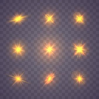 Zestaw świecącego żółtego złota wybucha na przezroczystym
