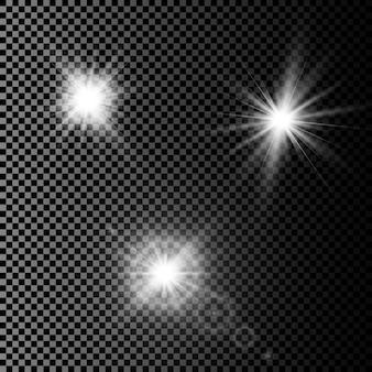 Zestaw świecących efektów świetlnych z przezroczystością na białym tle na kratkę. flary obiektywu, promienie, gwiazdy i błyszczy dzięki kolekcji bokeh.