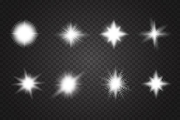 Zestaw świecących jasnych gwiazd z błyskami.