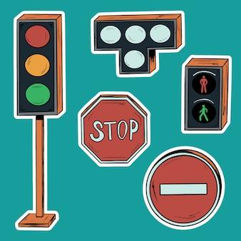 Zestaw sygnalizacji świetlnej i znaków drogowych na drodze.