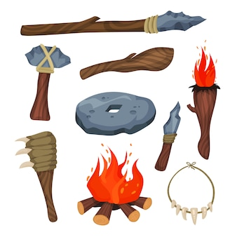 Zestaw symboli epoki kamienia, broń i narzędzia ilustracji jaskiniowca na białym tle