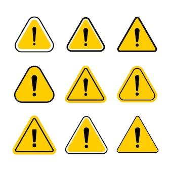 Zestaw symboli ostrzegawczych o zagrożeniach. ostrzeżenie na białym tle. płaski symbol z wykrzyknikiem.