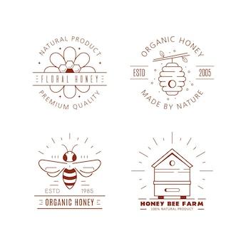 Zestaw szablonów projektów logo konspektu. etykiety miód ekologicznych i ekologicznych na białym tle. firma produkująca miód, opakowanie miodu.