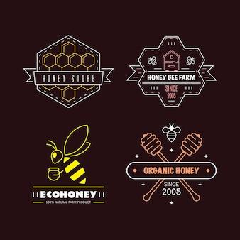 Zestaw szablonów projektów logo konspektu. etykiety miód ekologicznych i ekologicznych samodzielnie na czarnym tle. firma produkująca miód, opakowanie miodu.