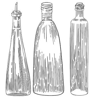 Zestaw szklanych butelek na białym tle