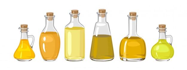 Zestaw szklanych butelek z olejem.
