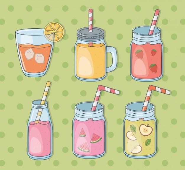 Zestaw szklanych pojemników z sokami owocowymi i słomkami