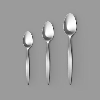 Zestaw sztućców srebrny łyżka stołowa łyżka deserowa i łyżeczka do herbaty na białym tle, widok z góry