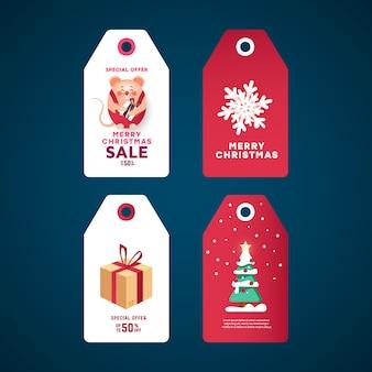 Zestaw tagów świątecznych prezentów. białe naklejki z pudełkiem prezentowym, świerkową sosną z gwiazdą i wystrojem z kulkami, płatkiem śniegu i myszą.