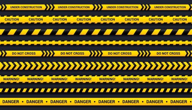 Zestaw taśm ostrzegawczych z żółtymi i czarnymi wstążkami, do stref niebezpiecznych, wypadków, policji. szablon taśmy z cieniem na ciemnym tle.