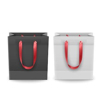 Zestaw toreb na zakupy z plastiku lub papieru z uchwytami, torby na zakupy w kolorach czarnym i białym, ilustracja