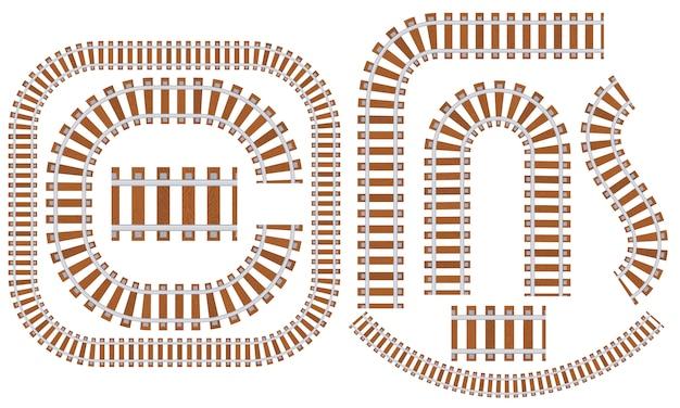 Zestaw torów kolejowych z podkładami o różnych kształtach.