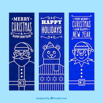 Zestaw trzech pionowych christmas banery w niebieskim dzwonka