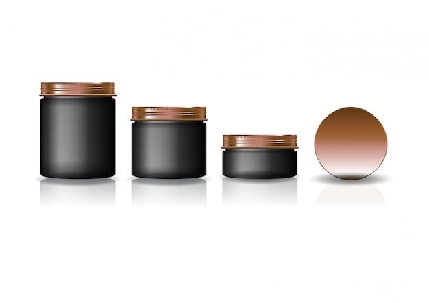 Zestaw trzech rozmiarów czarnego kosmetycznego okrągłego słoika z miedzianą pokrywką.