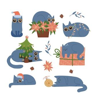 Zestaw uroczych kotów w zimowych strojach i bawiących się bombkami choinkowymi niegrzecznymi zwierzakami oszukującymi ...