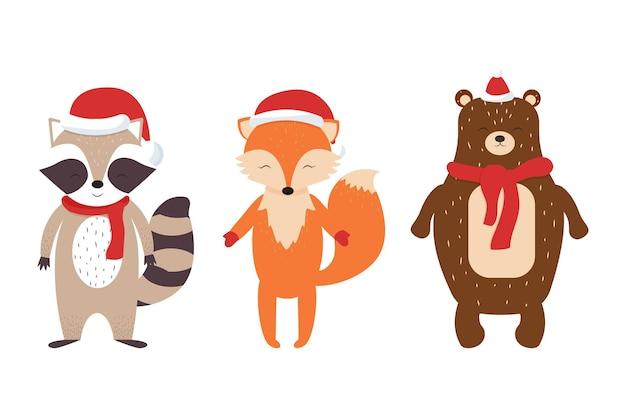 Zestaw uroczych skandynawskich zwierzątek lisa szopa pracza w świątecznych czapkach i szalikach
