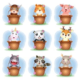 Zestaw uroczych zwierzątek w koszyku, postać ślicznej świni, jaka, tygrysa, jednorożca, nosorożca, szopa, hipopotama, pandy i jelenia