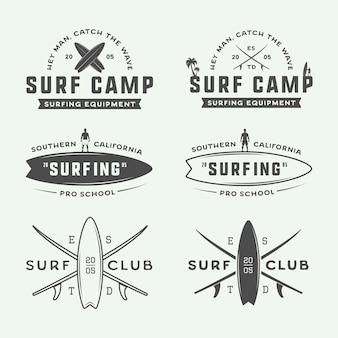 Zestaw vintage surfing logo, emblematy, odznaki, etykiety i elementy projektu. graficzna ilustracja wektorowa