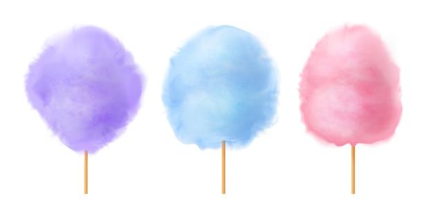 Zestaw waty cukrowej. realistyczne niebieskie fioletowe różowe bawełniane cukierki na drewnianych patyczkach.