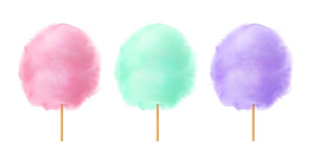 Zestaw waty cukrowej. realistyczne różowe zielone fioletowe bawełniane cukierki na drewnianych patyczkach. letnia smaczna i słodka przekąska dla dzieci.