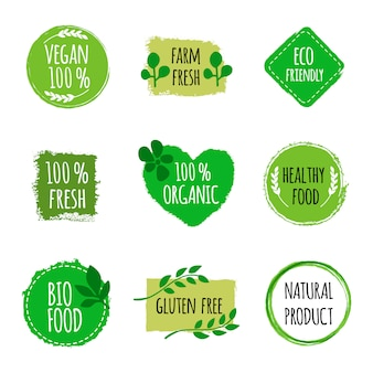 Zestaw wegańskie logo, odznaki, znaki. ręcznie rysowane odznaki bio, zdrowe jedzenie. wegańskie logo.