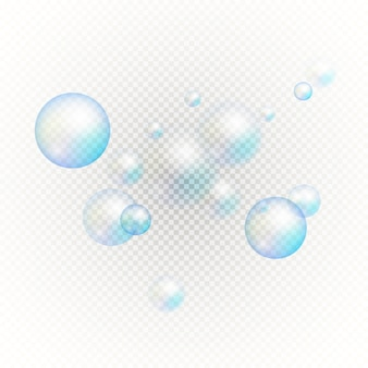Zestaw wielobarwnych przezroczystych baniek mydlanych.