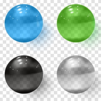 Zestaw wielokolorowych przezroczystych szklanych kulek z cieniami