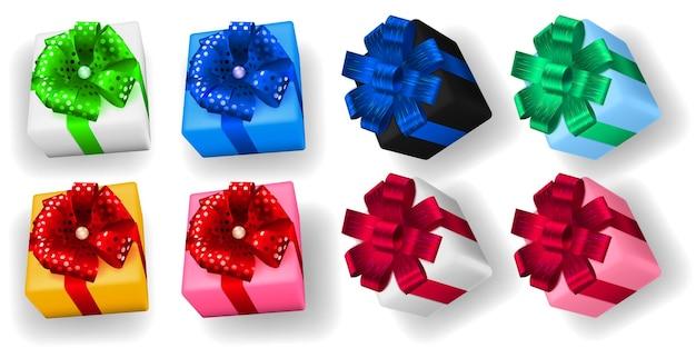 Zestaw wielokolorowych pudełek prezentowych ze wstążkami, kokardkami i cieniami