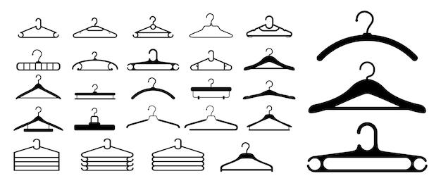Zestaw wieszaków na ubrania lub wieszaków na ubrania na białym tle
