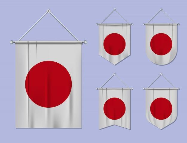 Zestaw wiszących flag japonii z tekstylnymi teksturami. różnorodność kształtów kraju bandery. proporczyk pionowy szablon