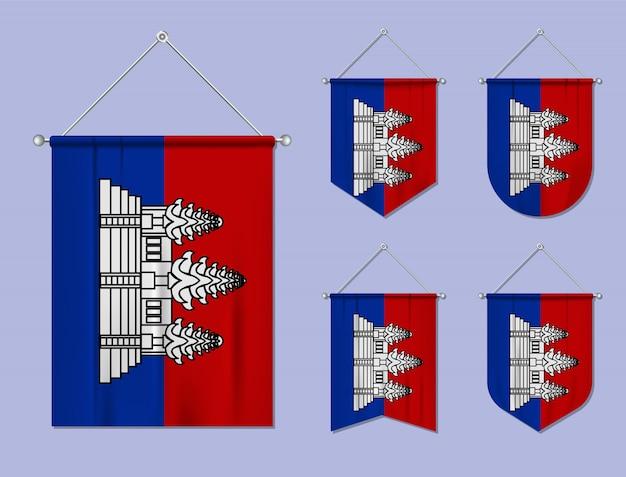 Zestaw wiszących flag kambodży z tekstylnymi teksturami. różnorodność kształtów kraju bandery. proporczyk pionowy szablon.