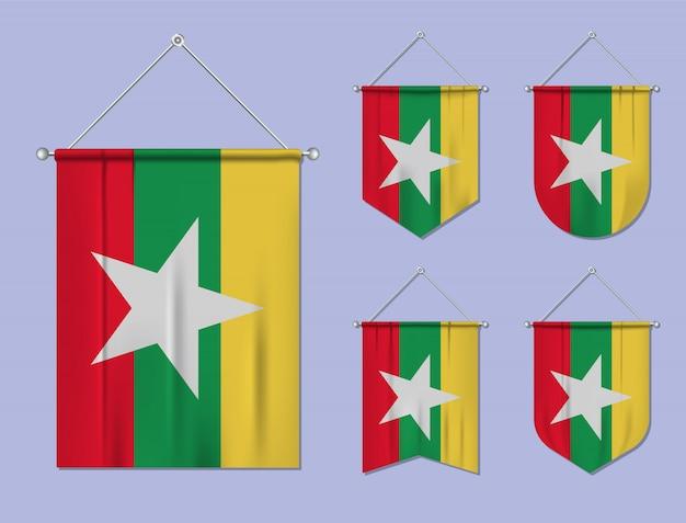 Zestaw wiszących flag myanmar z tekstylną teksturą. różnorodność kształtów kraju bandery. proporczyk pionowy szablon